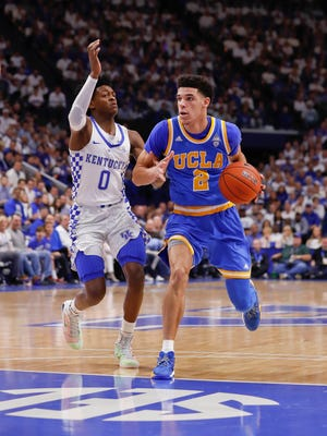 UCLA Bruins guard Lonzo Ball tries to drive on Kentucky Wildcats guard De'Aaron Fox.