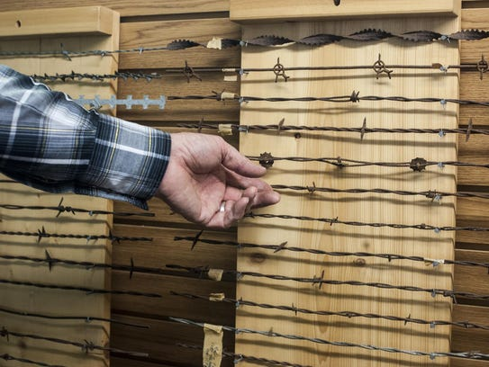 Bob Watts shows off a portion of his barbed wire collection,