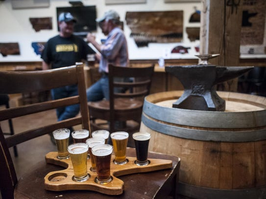 Blacksmith Brewing's anvil-shaped flight board is shown