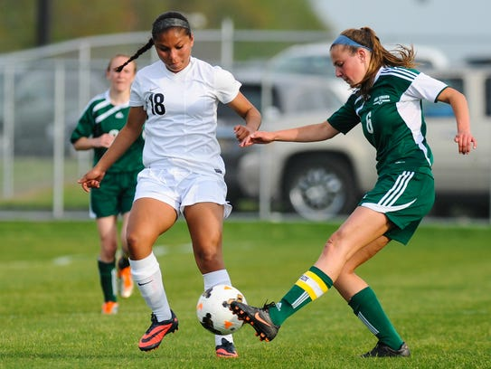 Sussex Tech forward Michelle Laz battles against Indian