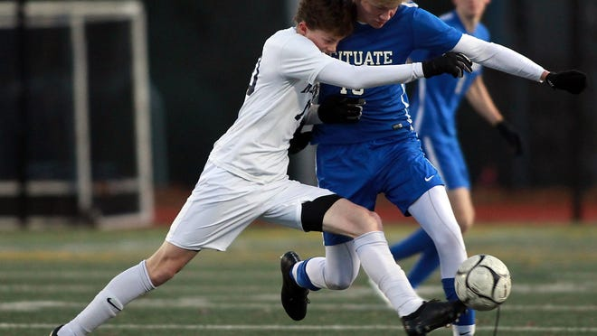 Medway's Luke Fagerson and Scituate's Gavin Roche battle for possession in the first half of their game in the Division 3 south semifinal at Medway High on Wednesday, Nov. 13, 2019.