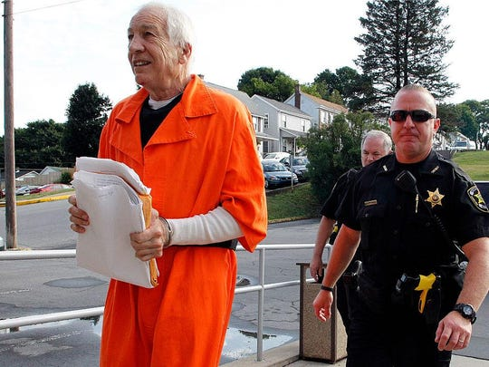 Jerry Sandusky enters the Centre County Courthouse to appeal his child sex abuse conviction in this August 12, 2016 file photo in Bellefonte, Pennsylvania. A Pennsylvania appeals court said Tuesday it is denying Sandusky's request for a new trial but is ordering him to be resentenced for a 45-count child sexual abuse conviction.