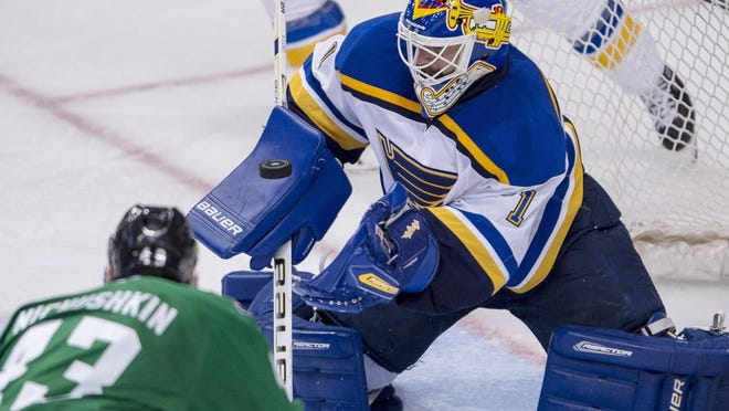 Blues goalie Brian Elliott (1) makes a save against Stars right wing Valeri Nichushkin during the third period in Game 5 of the second round of the Stanley Cup Playoffs at American Airlines Center. The Blues won 4-1.