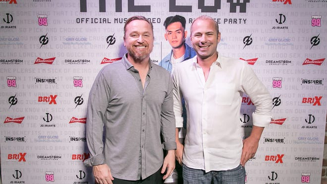 "Club owner Lee Heather, left, with JP Ford, right, a ""The Low"" music video release party in Tumon on April 7, 2017."