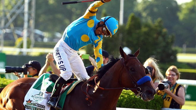 Victor Espinoza celebrates atop American Pharoah after winning the 147th running of the Belmont Stakes at Belmont Park on Saturday in Elmont, New York. With the win, American Pharoah becomes the first horse to win the Triple Crown in 37 years.