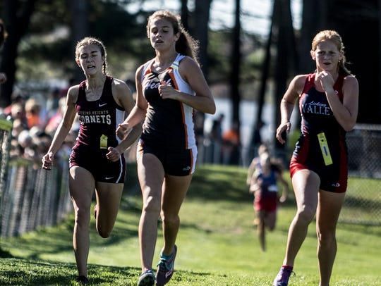 Licking Heights senior Kayla Wand, right, sprints to the finish during this past Saturday's Licking County League meet.