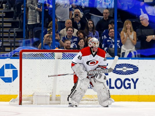 Carolina Hurricanes emergency backup goalie Jorge Alves makes his NHL debut during the third period of the team's NHL hockey game against the Tampa Bay Lightning on Saturday, Dec. 31, 2016, in Tampa, Fla. The Lightning won 3-1. (AP Photo/Mike Carlson)