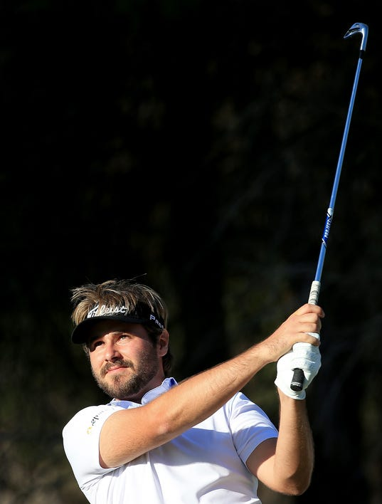 Victor Dubuisson leads Turkish Open, Tiger Woods tied for third