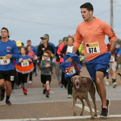 Thomas McLemore runs with his brother-in-law's dog