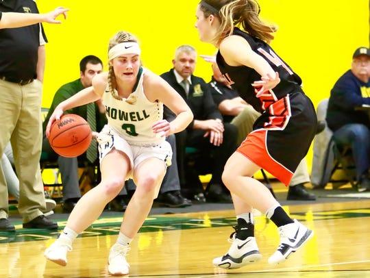 Howell's Paige Johnson dribbles against Northville's
