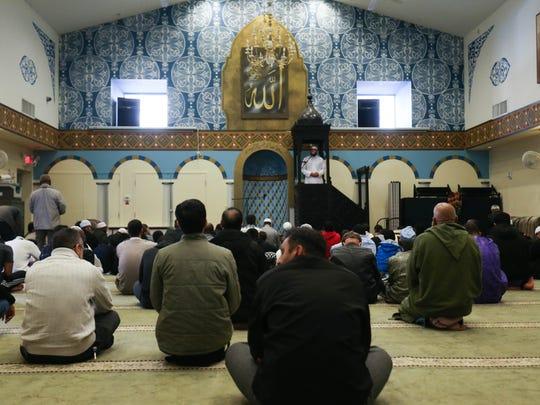 Sheikh Abdul Hadi Shehata speaks to congregants gathered for Jumah prayer at the Masjid Ibrahim in Newark.