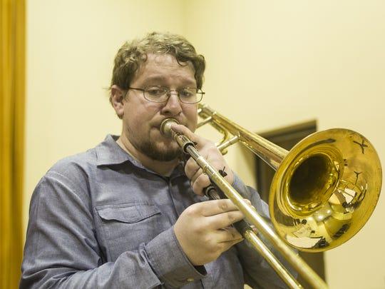 David Ellis of The Seminole Trombone Quartet joins practice at FSU on Wednesday..