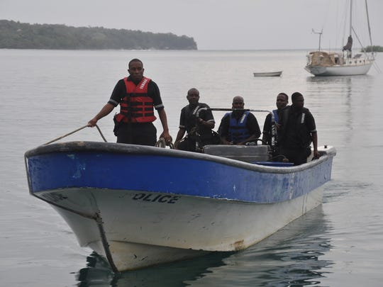 Jamaican Marine Police return to the Port Antonio Marina after a fruitless search for a plane that crashed into the ocean near Port Antonio, Jamaica, on Friday.