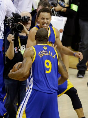 Golden State Warriors guard Andre Iguodala (9) celebrates with guard Stephen Curry (30) after winning Game 6 of basketball's NBA Finals in Cleveland, Tuesday, June 16, 2015. The Warriors defeated the Cavaliers 105-97 to win the best-of-seven game series 4-2.