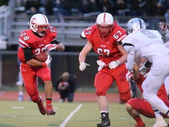 Chuck Turfe (No. 28) carries the football for the Canton