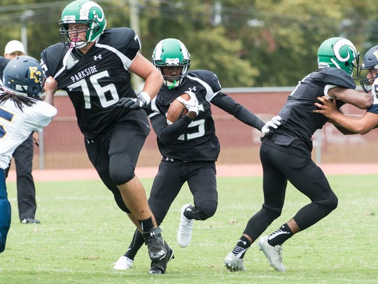 A Parkside player carries the ball during a game against