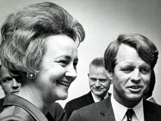 Katharine Graham and Bobby Kennedy attend a party at