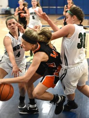 Northville's Brook Adams (middle) is squeezed out by