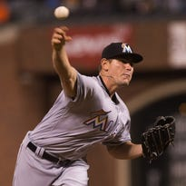 Miami Marlins relief pitcher Nick Wittgren (64) pitches against the San Francisco Giants during the seventh inning at AT&T Park on Friday, April 22.