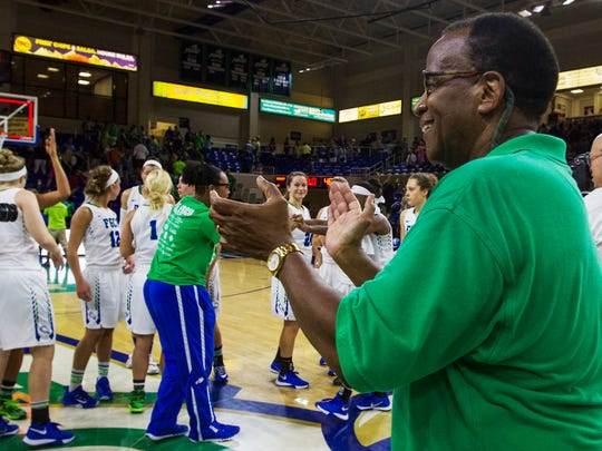 FGCU president Wilson Bradshaw cheers on the Lady Eagles