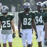 CSU wide receivers Joe Hansley (25), Rashard Higgins (82) and Xavier Williams (84) line up for drills at practice. Higgins needs the helps of his teammates more than ever this season.