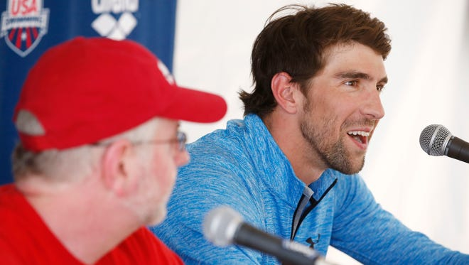 Michael Phelps talks to the media after his first offical practice session for the Arena Grand Prix swim meet on Wednesday, April 23, 2014 at Skyline Aquatic Center in Mesa.
