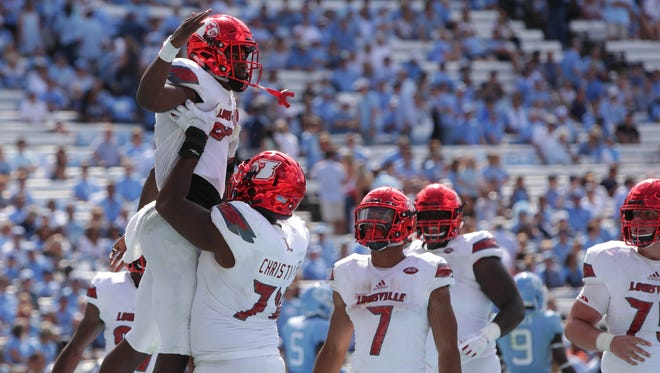 Louisville's Lamar Jackson is lifted int he air by teammate Geron Christian after scoring a touchdown in the fourth quarter against North Carolina. Sept. 9, 2017.