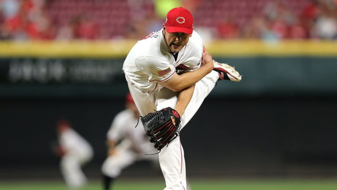 Cincinnati Reds relief pitcher Jared Hughes (48) follows through on a pitch in the eighth inning during an interleague baseball game between the Chicago White Sox and the Cincinnati Reds, Wednesday, July 4, 2018, at Great American Ball Park in Cincinnati. The Reds won 7-4.