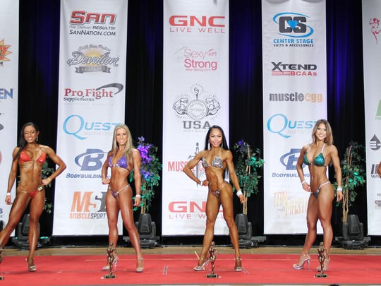 Rhea Macaluso, center, competed in the 2016 International Federation of Bodybuilding and Fitness Orange County Muscle Classic on Aug. 13, which qualified her for the Nationals in November in Miami. She took first place in the Novice Bikini A division and second place in the unlimited A division.