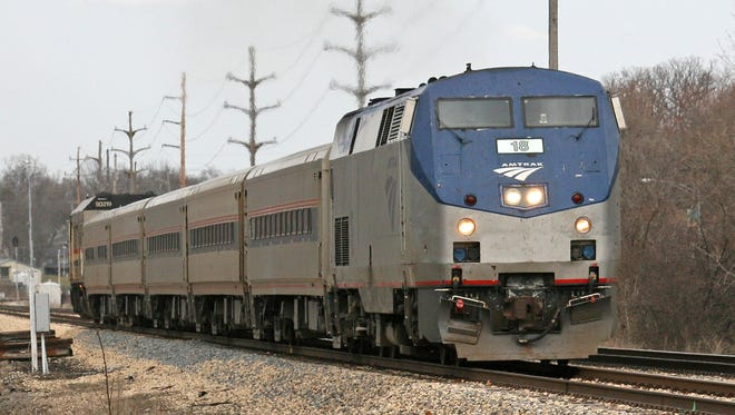 A high-speed Amtrak passenger train heading west past Western Michigan University in Kalamazoo, Mich.