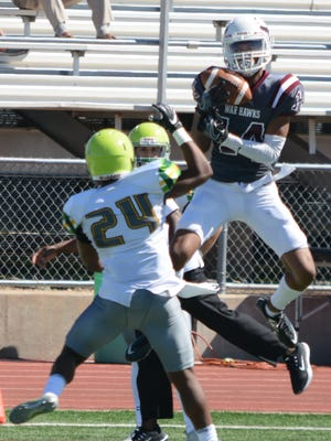 McMurry receiver Justin Eaton hauls in a pass over Belhaven cornerback Tridarius Williams before finishing off a 63-yard touchdown catch during the third quarter of the War Hawks' 42-30 homecoming win Saturday at Wilford Moore Stadium.