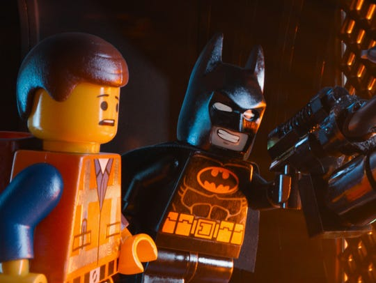 Emmet (left, voiced by Chris Pratt) and Batman were