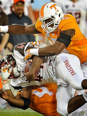 Tennessee defensive lineman Kyle Phillips top assists on a tackle against Bowling Green last season.