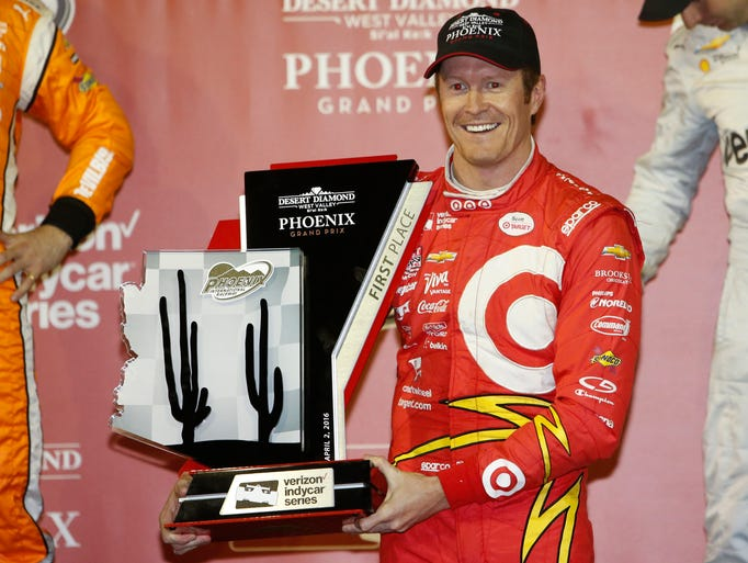 Scott Dixon poses with the trophy after winning the