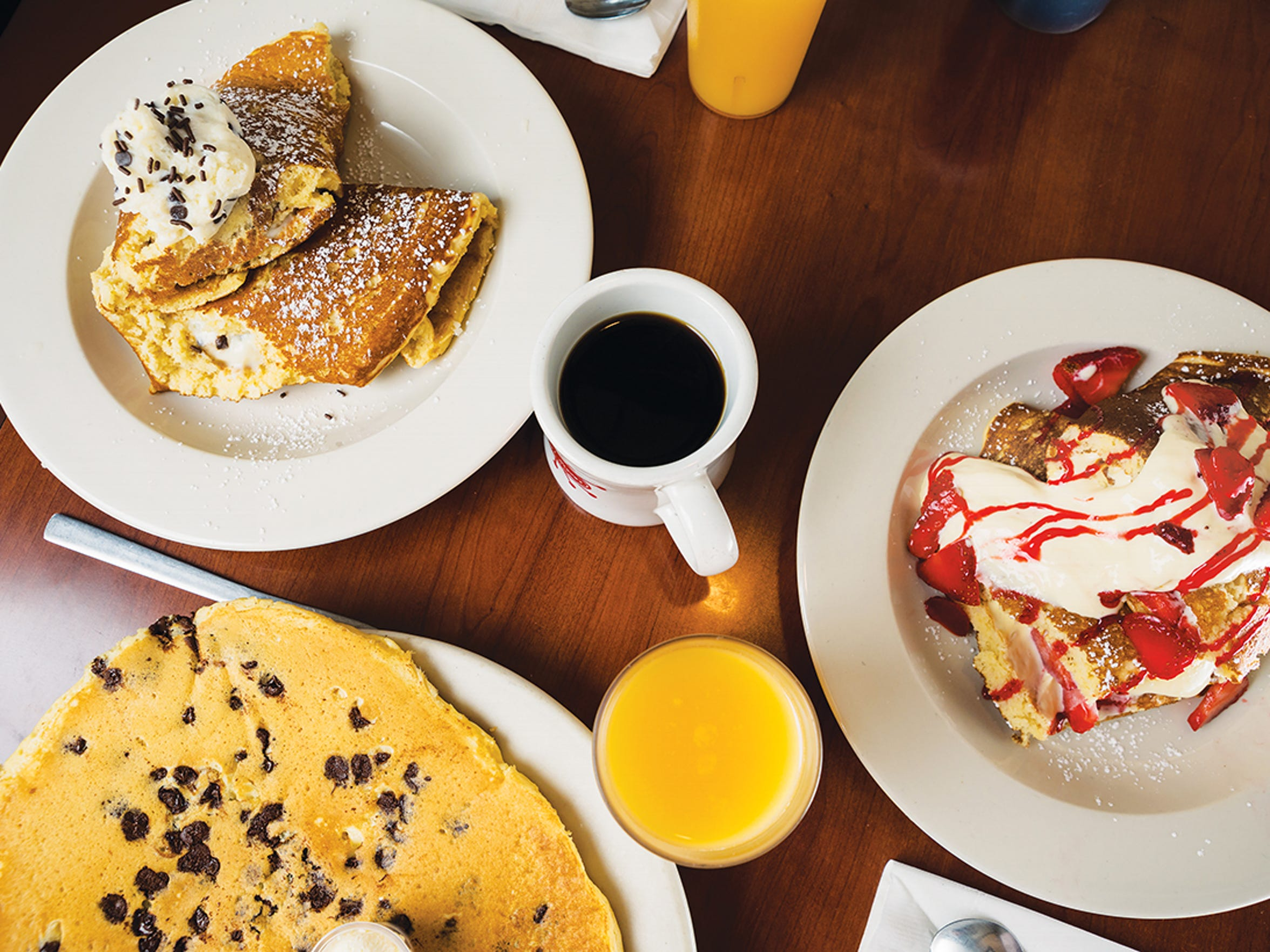 Cannoli pancakes,  strawberry cheesecake pancakes and chocolate chip pancakes at The Original Steve's Diner.