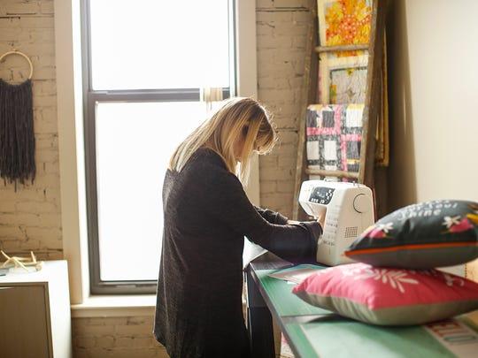 Lucinda working in her studio