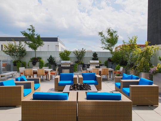 The rooftop includes a barbecue and lounge area, plus