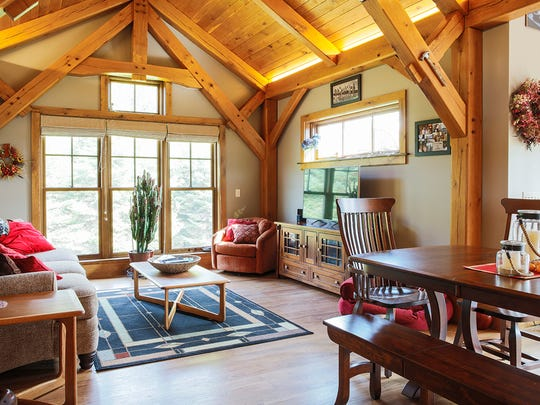 The hybrid interior of Dishaw and Lanni's side of the house has white oak beams, and flooring throughout both homes is hickory with walnut stain.