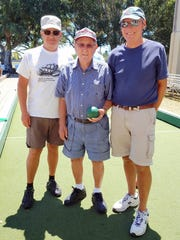 Jeff Peterson, left, Manny Puglisi, and John Martini were among the Marco Island bocce players at the get-acquainted games at Mackle Park on Friday, April 7.  Manny is 93 years old.
