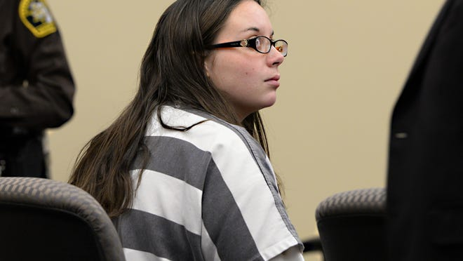 Melissa Mitin listens to attorney Frank Reynolds in court during her competency hearing Feb. 19. Mitin is charged in the December 2013 death of her infant daughter, and her newborn son is now missing. Mitin's trial has been pushed to 2016.
