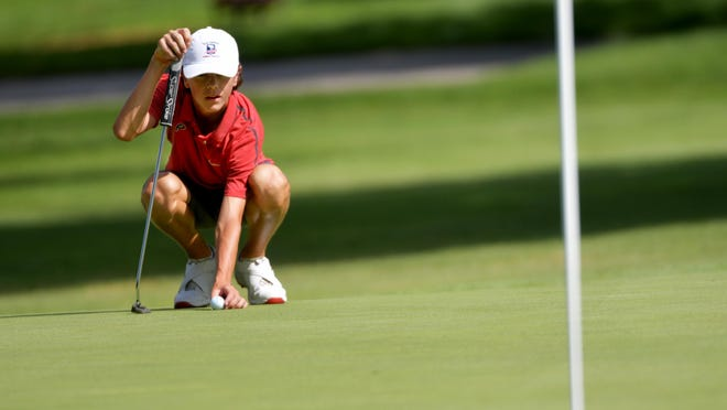 Mason Minkel of Pekin sets his line on a green in the D.A. Points Junior Championship golf tournament at Pekin Country Club.
