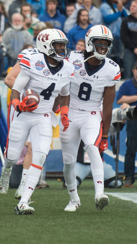 Auburn wide receiver Jason Smith (4) celebrates with Auburn wide receiver Tony Stevens (8) after scoring a touchdown during the NCAA football game in the Birmingham Bowl on Wednesday, Dec. 30, 2015, at Legion Field in Birmingham, Ala.Albert Cesare / Advertiser