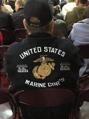A veterans wears a jacket honoring the U.S. Marine