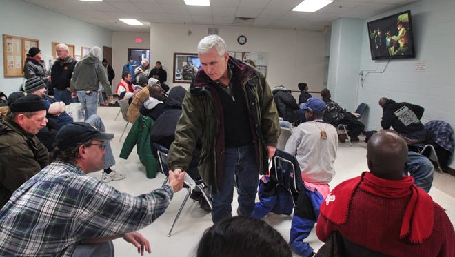 Indiana Gov. Mike Pence and his wife Karen (not shown) visited with homeless men seeking shelter from the minus double-digit temperatures at Wheeler Mission in Downtown Indianapolis on Monday, January 6, 2014. The Pences then went over to the American Red Cross disaster shelter to encourage families seeking shelter there. Indianapolis was pummeled by more than 11 inches of heavy, wet snow on Sunday.