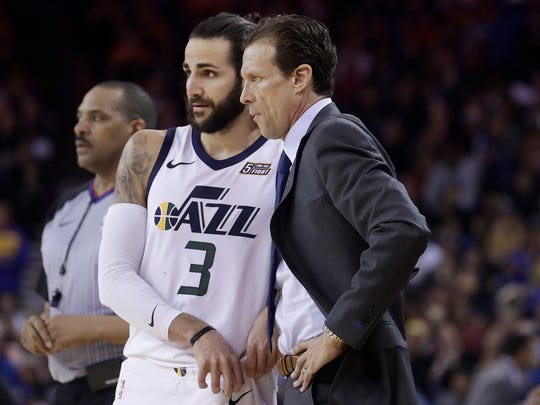 Utah Jazz head coach Quin Snyder, right, talks with guard Ricky Rubio (3) during the second half of an NBA basketball game against the Golden State Warriors in Oakland, Calif., Sunday, March 25, 2018. (AP Photo/Jeff Chiu)