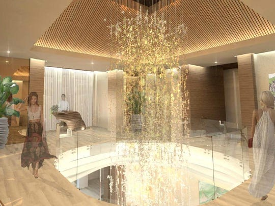 The revamped spa will feature a soaring ceiling with a chandelier plunging through an open central loft, and more modern décor.