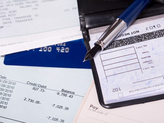 Bill, credit card and a checkbook