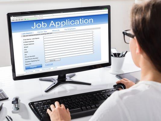 Woman Filling Job Application