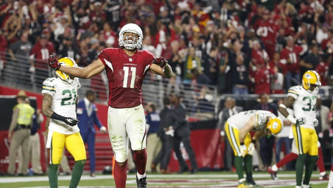 Arizona Cardinals WR Larry Fitzgerald celebrates after a 75-yard catch and run against the Green Bay Packers during overtime in the NFC divisional playoff game in Glendale, Ariz. January 16, 2016.