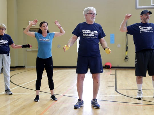 Katie Dubois, an instructor at Western Racquet & Fitness Club, second from left, volunteers during a Rock Steady Boxing class at Western Racquet & Fitness in Ashwaubenon. Also pictured are Marilyn Schlaefer, Ross Brudenell and Ron Kouba.